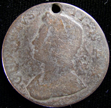 click for larger picture of Holed Coin