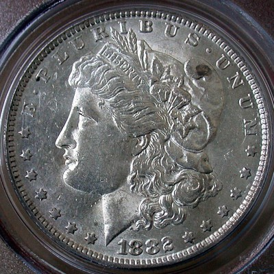 click for larger picture of 1882 O/S Morgan Dollar (O over S)