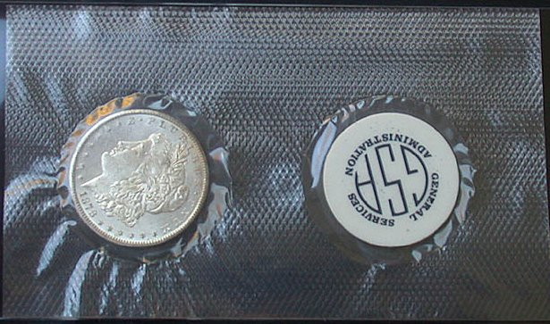 click for larger picture of 1878 CC Morgan Dollar in GSA Soft Pack