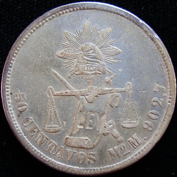 click for larger picture of 1877 M Mexico 50 Centavos