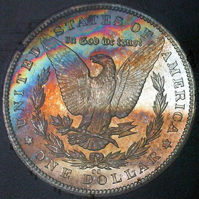 click for larger picture of 1884 CC Morgan Dollar Toned